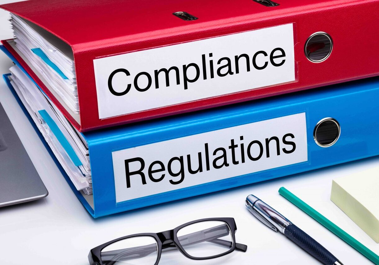 Compliance And Regulation With Office Supplies Over Business Desk
